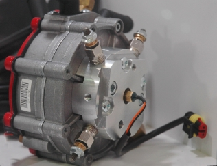 An AC reducer with an electrical heater on it